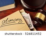 Small photo of Alimony concept. An envelope with cash on a table.