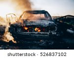 Burnt Car With Small Flames...