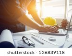 architect man working with laptop and blueprints,engineer inspection in workplace for architectural plan,sketching a construction project ,selective focus,Business concept vintage color - stock photo