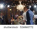 groom holds bride's hand... | Shutterstock . vector #526860772