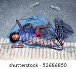 Small photo of KATHMANDU, NEPAL - APRIL 6, 2010: A little boy sleeping on the street.