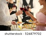 people clinking glasses at... | Shutterstock . vector #526879702