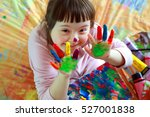Cute little girl with painted...