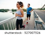 Athletic Couple Jogging...