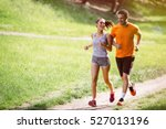 couple jogging and running... | Shutterstock . vector #527013196
