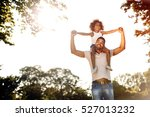 father carrying daughter on... | Shutterstock . vector #527013232
