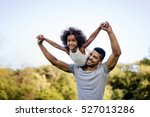 father carrying daughter on... | Shutterstock . vector #527013286