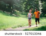 couple jogging and running... | Shutterstock . vector #527013346