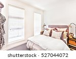 modern bedroom with pillows on... | Shutterstock . vector #527044072