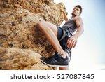 young brunette man climbing... | Shutterstock . vector #527087845
