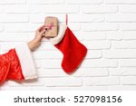 female hand gets present... | Shutterstock . vector #527098156