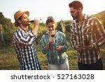 happy wine tourists tasting... | Shutterstock . vector #527163028
