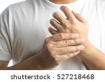 wedding ring on a man's hand | Shutterstock . vector #527218468