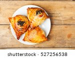 triangular pies of puff pastry... | Shutterstock . vector #527256538