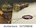 Small photo of wax seal on document
