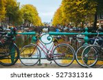Stock photo utrecht canal in the center of the city at sunset bicycles standing on the bridge with an amazing 527331316
