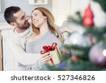 couple with christmas present | Shutterstock . vector #527346826