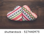 Two Knitted Heart Shapes On Th...
