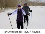 senior couple skiing cross... | Shutterstock . vector #527478286
