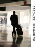 male traveler walking in airport - stock photo