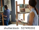 young female artist painting... | Shutterstock . vector #527490202