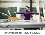 women worker using saw machine... | Shutterstock . vector #527563222