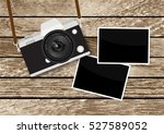 camera on wooden table | Shutterstock .eps vector #527589052