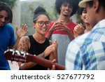 young people listening to a... | Shutterstock . vector #527677792