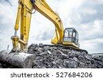 yellow excavator is making pile ... | Shutterstock . vector #527684206