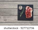 Raw Beef Steak In Craft Paper...