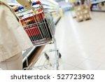 woman pushing shopping trolley...