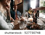 man hand pouring white wine... | Shutterstock . vector #527730748
