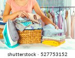 housewife bringing a huge pile... | Shutterstock . vector #527753152