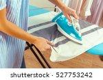 closeup of woman ironing... | Shutterstock . vector #527753242