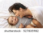 young mother playing with her... | Shutterstock . vector #527835982