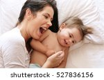 young mother playing with her... | Shutterstock . vector #527836156