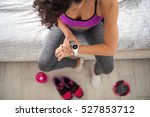 woman checking her workout time ... | Shutterstock . vector #527853712