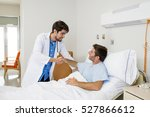 doctor consulting patient lying ... | Shutterstock . vector #527866612