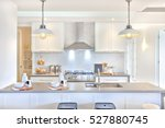 Stock photo luxury kitchen with the counter and stoves under lights near chimney 527880745
