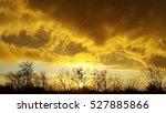 Sunset. Orange Clouds. Dark...