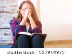 woman praying on holy bible in... | Shutterstock . vector #527914975