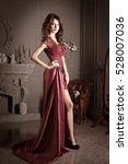 Small photo of Attractive woman in long claret lace dress. Retro, vintage