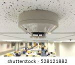 Small photo of ceiling white fire detector used to activate warning systems in residential buildings, select focus at fire detector