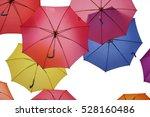 multicolored umbrellas hanging... | Shutterstock . vector #528160486