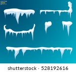 set of snow icicles  snow cap... | Shutterstock .eps vector #528192616