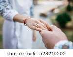 hands of a engaged couple ... | Shutterstock . vector #528210202