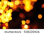 Small photo of Bokeh of candles amber light