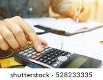close up man using calculator... | Shutterstock . vector #528233335