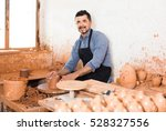 smiling artisan man creating...   Shutterstock . vector #528327556