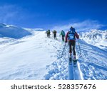 group of touring skiers  the... | Shutterstock . vector #528357676